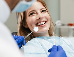 Woman smiling during dental checkup and cleaning