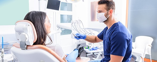 Dentist talking to patient at routine appointment