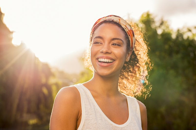 smiling in summer sun oral health benefits